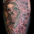 Skull collage tattoo