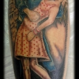 Couple kissing tattoo