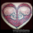 Heart surrounding skulls
