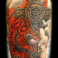 Tiger cross tattoo