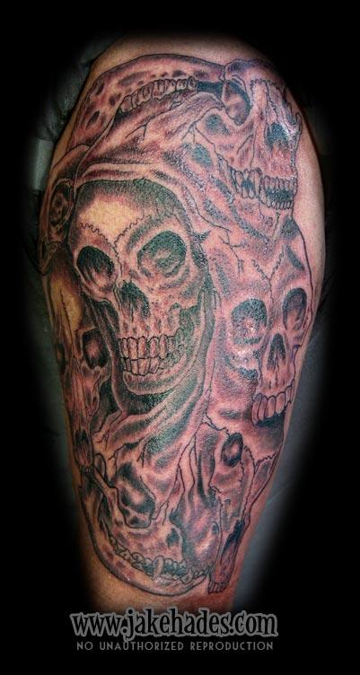 Skull collage tattoo